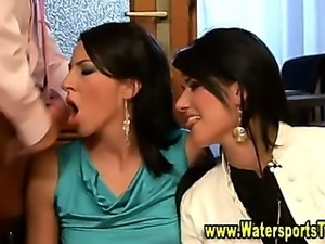 Glamorous fetish threesome gets soaked