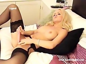 Blonde lesbian with big tits climaxes with her big pink toy
