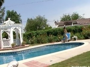 petite brunette Kandi sucking cock by the pool