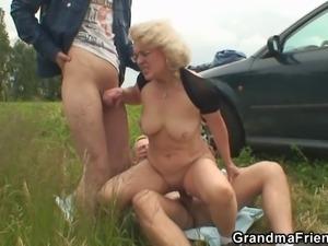 Old slut swallows two cocks in fields
