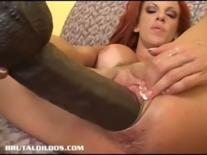 Busty redhead fills her pink pussy with a gigantic dildo free