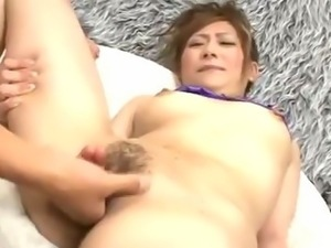 Innocent Miku Haruno spreads her legs for a nasty fingering that leaves her...