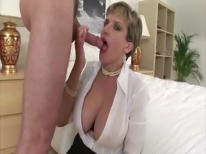 Mature dirty slut Lady Sonia puts her tits to work jerking free