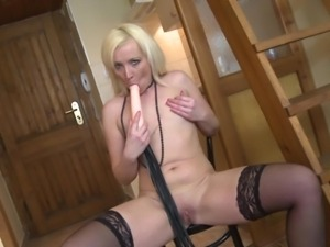 mature rubbing her shaved cunt and enjoying her sex toy