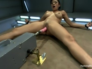 brunette satisfying her pussy and anus with a fucking machine