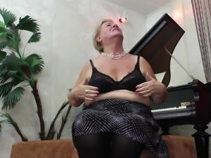 stylish gilf plays the piano and then with her nipples