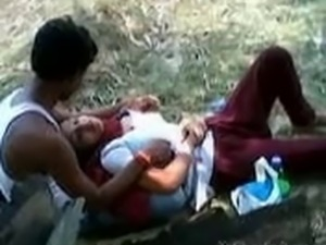 Indian Girl allow to play her lover with her Boobs in a Park