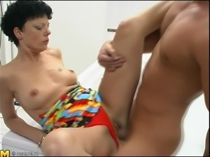 brunette mature fucking in the bathroom and bath tub