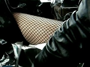 st pvc mac and fishnet stockings
