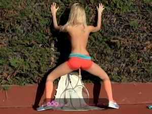 blonde teen playing tennis and taking a break