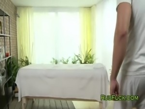 Beautiful brunette gets massage with oil free