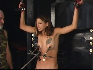 Pretty brunette gets ass whipped, clamps on her cute tits