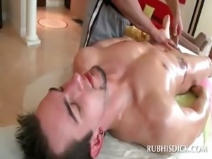 Lustful gay masseur rubbing his horny clients dick