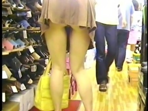 Upskirt at shoestore