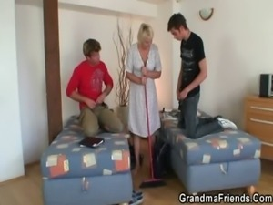 Old cleaning woman takes two cocks free