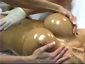 Ashley Lawrence gets rubbed down and her pussy rubbed by a female and her...