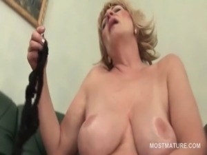 Nasty blonde mature shoving her panties in snatch free