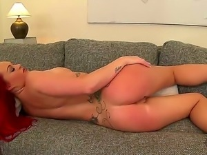 Horny redhead slut Paige Delight rubs her gentle nipples and masturbates with...
