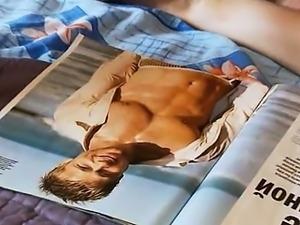 Teen posing and watching magazine