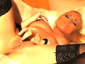 Fascinating blonde Kathia Nobili wakes up early in the morning and starts to...