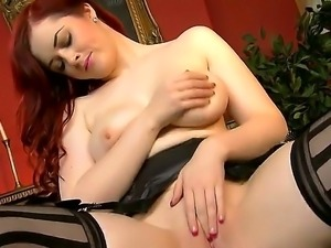 The seductive redhead whore Jaye with the gigantic boobs penetrates her...