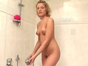 The sympathetic blonde whore Regina with a natural tits demonstrates her body...