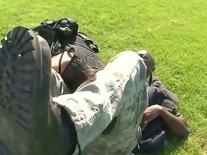 Slutty brunette in military uniform is deepthroating a huge dick of an ebony guy