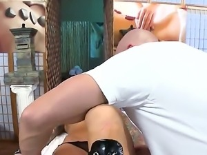 Dirty masseur is touching and petting nude body and pussy of a tattooed blonde