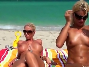 Beautiful and sexy blondes Jc Simpson and Molly Cavalli love to tan topless...