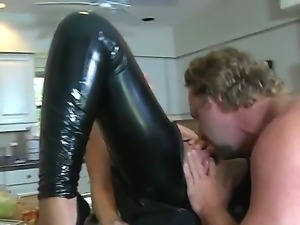 Wonderful blonde babe in sexy black latex pants is having an awesome cock...