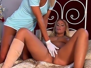 Two gorgeous blonde lesbians Jana and Kelly H. play in a doctor and caress...