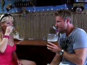 Blonde mature teases younger stud in the bar and makes him follow her