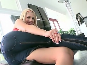 Busty chick Christie Stevens is taking off her tight jeans and is showing her...