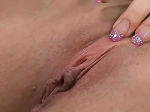 Big hot-ass brunette Virginia Ducatti enjoys working her pink pussy with her...