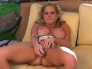 Marvelous blonde babe with gorgeous titties Ainsley Addison likes her dildo...