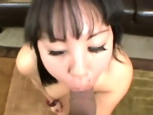 Asian babe Tina Lee plays with her pussy and sucks a big and strong cock