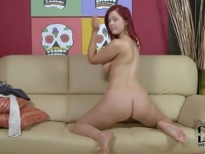 Attractive redhead Jaye Rose is totally naked showing her curves.