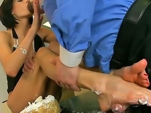 Foot fetish scene with a horny brunette with a shaved pussy named Liz