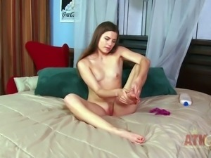 Young brunette Christie Nelson is totally naked posing and playing