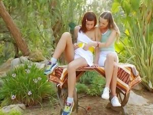 Topless cuties Ivana and Natasha have lesbian fun in the
