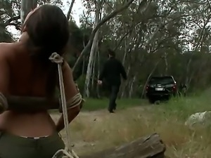 Busty brunette was caught and roped by a few guys in the forest and sexually...