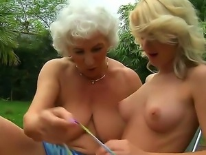 Horny lesbian grannies Candy Lover and Norma enjoy getting intimate under the...