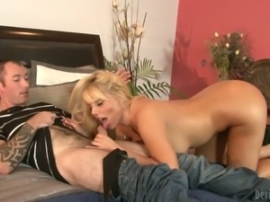 Long haired sexy blonde milf Karen Fisher strips naked before