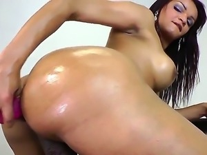 The seductive brunette she-male with a tasty boobs masturbates and penetrates...