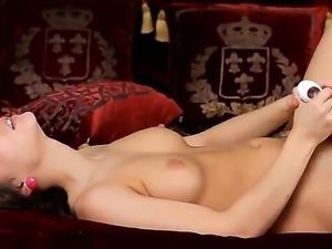 Alluring brunette babe Penelope fingers her shaved taco before sliding a huge...