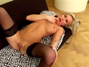 Busty glamour model fingering her wet pussy in thigh high stockings