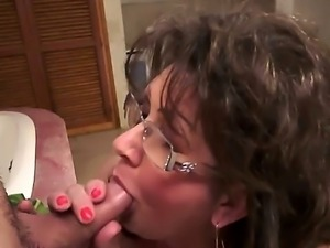 Redhead Gigi M with giant boobs puts her soft lips on sturdy meat pole
