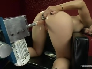 pleasured by a big dildo strapped to a machine