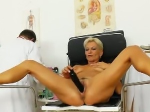 Blonde mom has a gyno exam