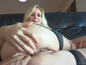 Julia Ann is s curvy blonde milf with big ass. Woman in nylons shows off her...